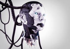 The head of a cyborg with wires on a gray background. Royalty Free Stock Image