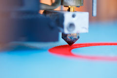 Head of 3d printer in action Royalty Free Stock Image