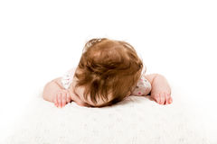 Head down lying baby on bed Stock Images