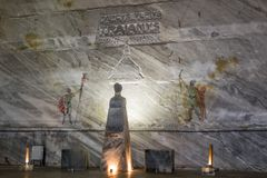 The head of Emperor Trajan is carved from salt on a pedestal and wall drawings in salt mines in Slanic - Salina Slanic Prahova - Royalty Free Stock Image
