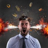 Head explosion of a businessman. concept of stress due to overwork. Head explosion of a stressed businessman. concept of overwork and failure royalty free stock photos