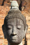 Head and face of ancient stone grey buddha statue, art sculpture Stock Image
