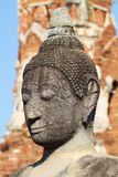Head and face of ancient stone grey buddha statue, art sculpture Royalty Free Stock Image