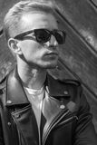 Head face close up young man sunglasses cool black and white Stock Image