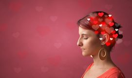 Head with full of love. Red background and hearts stock images