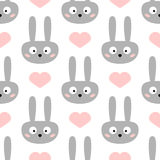 Head of funny rabbit with big eyes. Cute hearts. Seamless pattern for children. Royalty Free Stock Photos