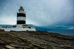 Head fyr för krok i Irland Arkivfoto