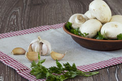 Head of garlic and mushrooms Stock Image