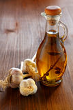 Head of garlic and olive oil bottle Royalty Free Stock Image