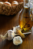 Head of garlic and olive oil bottle on a table Stock Photography