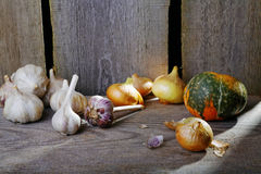 Head of garlic and onionn on the table Royalty Free Stock Photo