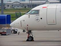 Head of Garuda. Garuda Indonesia Bombardier CRJ-1000 parked at Kuala Namu Airport in North Sumatera, Indonesia Royalty Free Stock Image