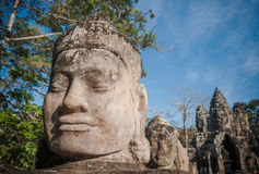 Head of gate guardian, Angkor, Cambodia Royalty Free Stock Photos
