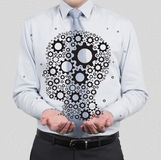 Head with gears. Businessman drawing head with gears Royalty Free Stock Photo
