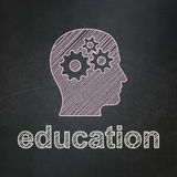Head With Gears and Education on chalkboard. Education concept: Head With Gears icon and text Education on Black chalkboard background, 3d render Stock Image