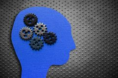 Head and gears. On rivet metal background Stock Photo