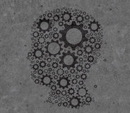 Head with gears. Silhouette of head with gears drawing on wall Royalty Free Stock Images
