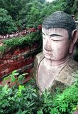 The Head of Giant Buddha. It is so large that the people afar looks as small as ants.the Giant Budda is in Le Shan City,Sichuan,China. The Giant Buddha Statue Stock Photos
