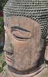 Head of the giant buddha statue in the rock stock photography