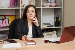 Head girl at desk in the office Royalty Free Stock Image