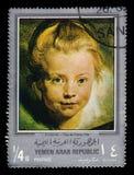 Head of a girl, paintings by Rubens. Yemen - CIRCA 1968: stamp printed in Yemen Arab Republic, shows head of a girl, paintings by Rubens, silver frame, circa stock image
