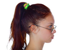 Head of the girl in a profile on a white Royalty Free Stock Photos