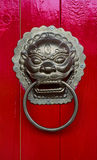 Head gold lion knock ,Chinese style. Head gold lion knock on the red wooden door Stock Photo