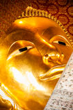 Head of golden reclining Buddha in Wat Pho Stock Photos