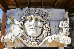 Ancient stone carving of Medusa Head. Stock Photography