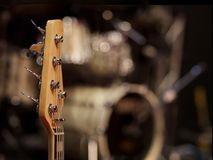 The head of a guitar neck on the stage 1 stock image