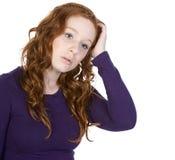 head hövdat henne röd skrapande tonåring Arkivbilder