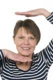 Head between hands vertical Stock Images