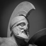 Head in helmet Greek ancient sculpture of warrior Stock Photo