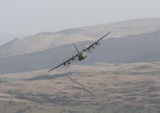 Head-on Hercules. An RAF Hercules approaches the photographer in North Wales stock photography
