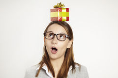 Head holding gift Stock Photos
