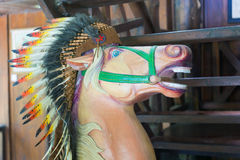 Head of horse statue with an Indian headdress of feathers Stock Image