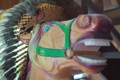Head of horse statue with an Indian headdress of feathers Stock Photography