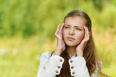 Head hurts young beautiful woman Royalty Free Stock Image