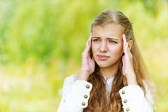 Head hurts young beautiful woman Stock Images