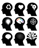 Head icons with idea symbols Stock Photos