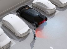 Free Head-in Parking Black Car Emergency Stopped When The Rear Sensor Detected Pedestrian Near The Car Royalty Free Stock Photography - 153559297