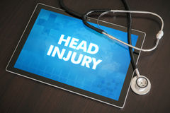 Head injury (neurological disorder) diagnosis medical concept. On tablet screen with stethoscope stock images