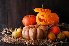 Head jack lantern on wooden background Stock Photography
