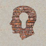 Head with a Keyhole Icon on the Wall. Stock Photos