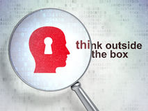 Head With Keyhole and Think outside The box. Education concept: magnifying optical glass with Head With Keyhole icon and Think outside The box word on digital royalty free stock photography