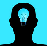 Head Lamp. The lamp inside of head silhouette. Concept of good idea Stock Photo