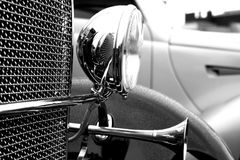 Head lamp of Classic car. Wet  Vintage car close up view Royalty Free Stock Images
