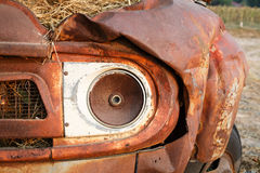 A head lamp of an old Pickup truck. Rusty and moldy royalty free stock images