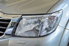 Head lamp of white car royalty free stock photography