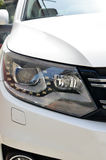 Head lamp of white car. Close-up of a new modern car head Royalty Free Stock Photo